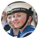 Girl Sea Cadet smiling with her friend in uniform