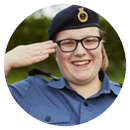 Teenage girl Sea Cadet smiling and saluting
