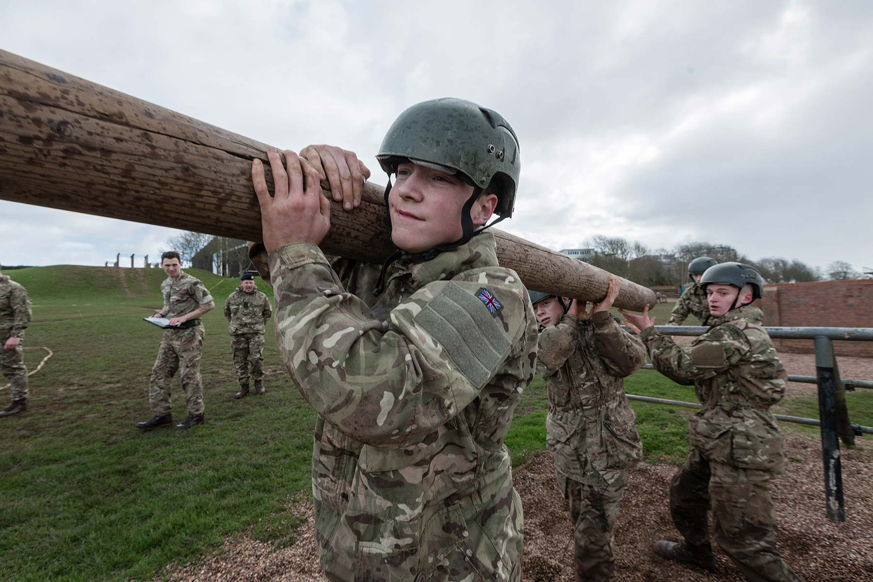 Royal Marine cadets working as a team to carry a log