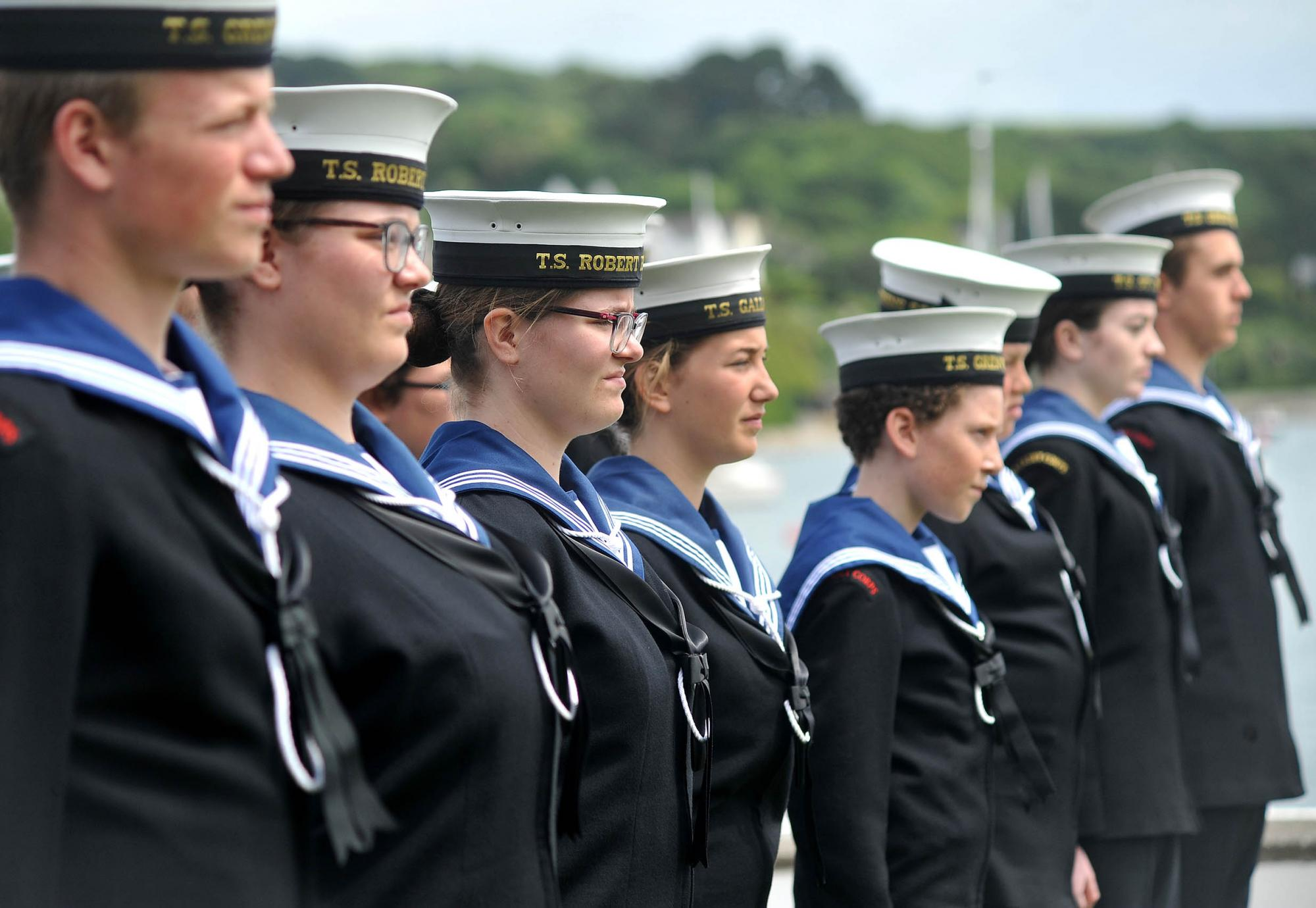 Sea Cadets lined up in uniform by the water