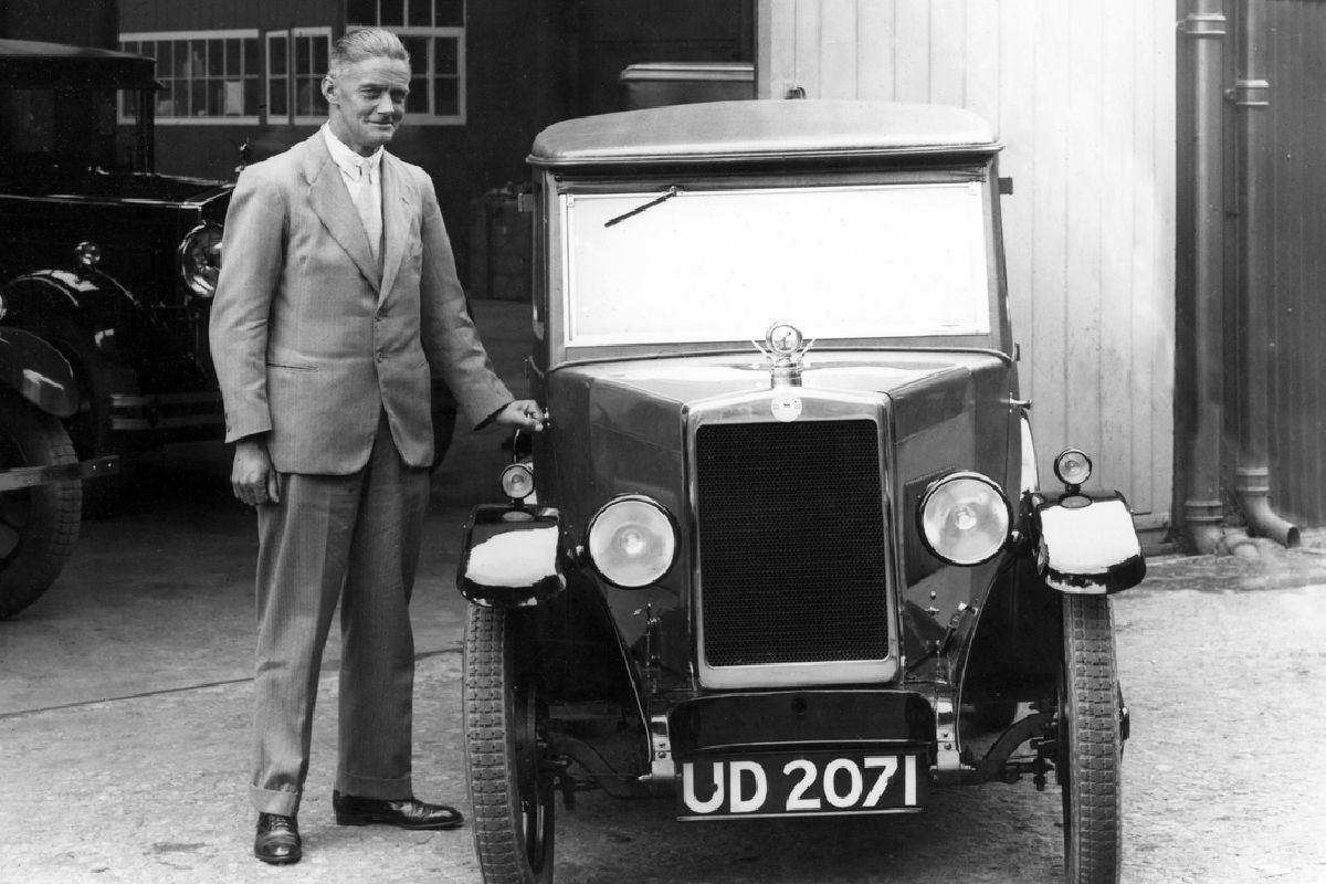 Lord Nuffield standing next to a Morris motor